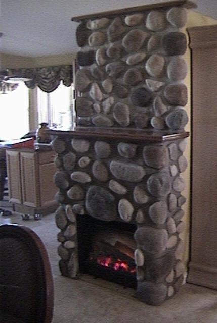 the Stoveman Inc Fireplace Mantle and Surround